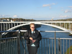 Betsy at Niagara Falls with the Rainbow Bridge in the background.