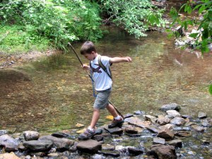Sean crossing a creek on rocks instead of using the bridge.  July 10, 2009.