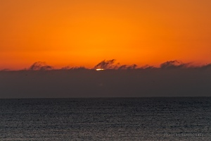 The sun making an appearance off Ocean Isle Beach.  December 14, 2012.