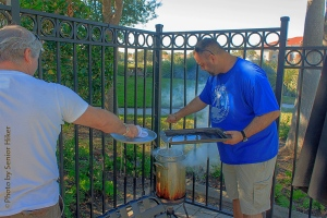 Robert and Darron putting turkey breasts into the fryer.  November 28, 2013.