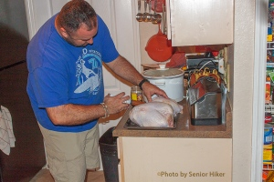 Bob injecting Cajun marinade into turkey breasts, Palm Harbor, Florida.  November 28, 2013.